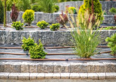 irrigation hose surrounding outdoor plants on patio