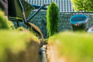 inground irrigation hose being put in place