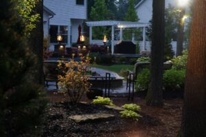 backyard stone patio with lamps