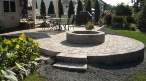 outdoor stone patio with brick fire pit