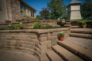outdoor stone patio with flowers and plants