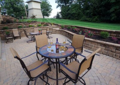 outdoor stone patio with wine glasses on table