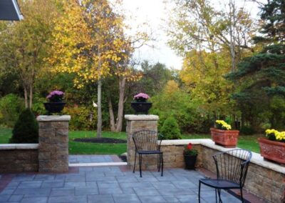 stone patio with flowers pots