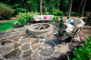 stone patio with inground fire pit