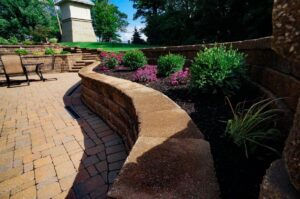 stone patio with plants lining wall